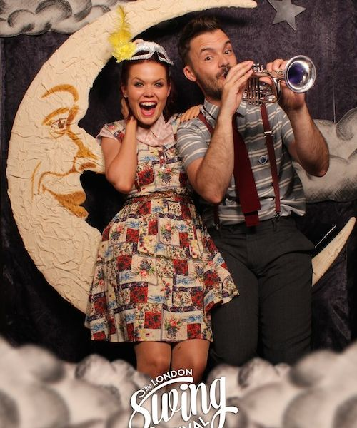 Blue Peter presenters try out the Paper Moon photo booth at the London Swing Festival
