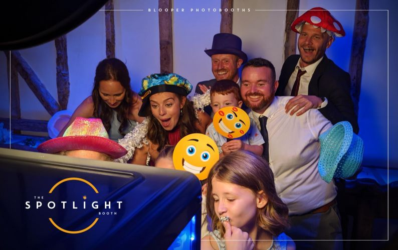 Wedding guests at South Farm having fun with the Spotlight photo booth in the Horse Barn