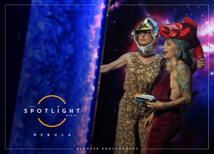 Guests at the National Space Centre using the outer space 'Nebula' themed photo booth