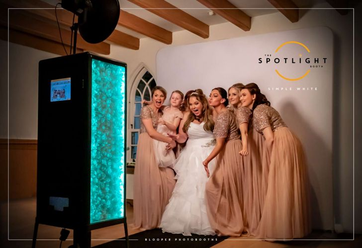 Bride and bridesmaids with a white backdrop using the Spotlight open photo booth