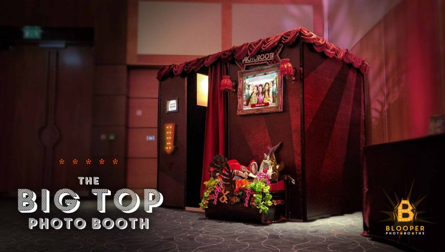An extra large photo booth at an event with a looping slideshow