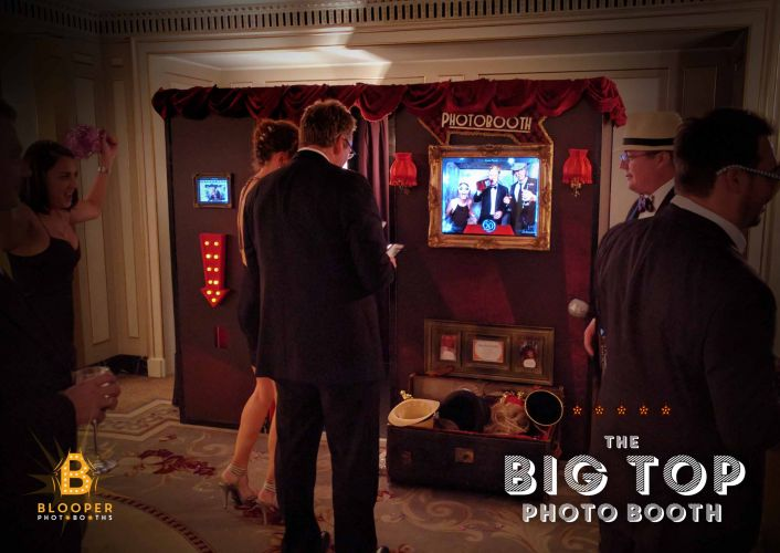 Guests at an event outside the extra large Big Top photo booth