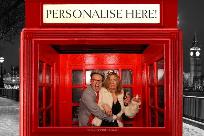 A couple in the London themed phone box background photo booth scenery