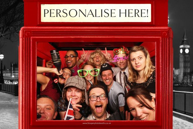 Wedding guests enjoying the phone box themed scenery in the Big Top photo booth
