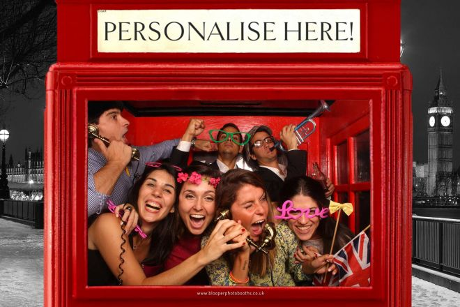 A large group of party guests in the extra large phone box themed photo booth