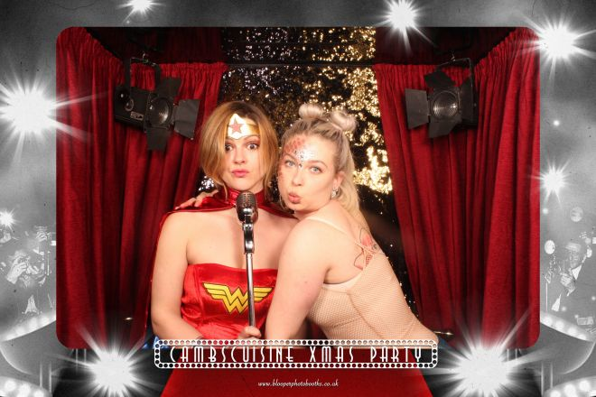 A Red Carpet themed backdrop in the Big Top photo booth at a fancy dress Christmas party