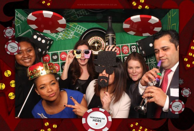 Six guests amongst the Casino themed photo booth scenery and personalised graphics