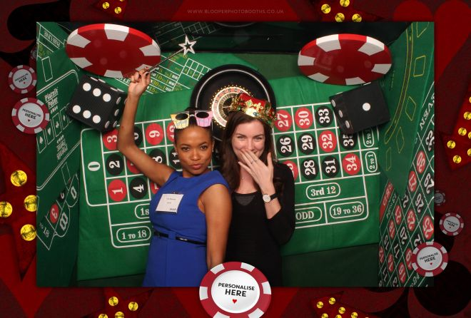 Casino themed scenery and party guests inside the photo booth