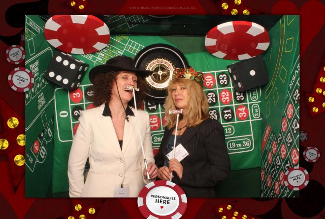 Giant poker chips and over-sized dice inside our Casino themed photo booth
