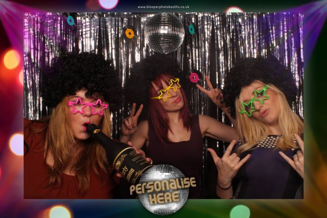 3 girls with matching afro wigs and starry glasses in the Disco themed photo booth scenery
