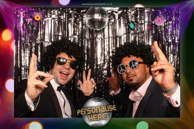 Two guys with matching Disco photo booth props and matching poses