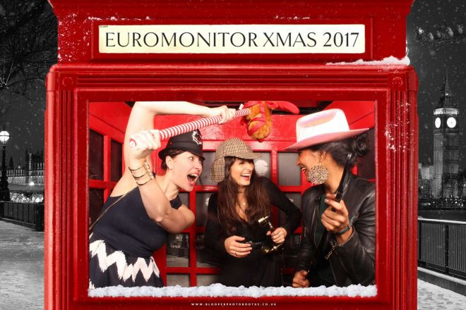Christmas themed red London phone box themed photo booth with snowy graphics