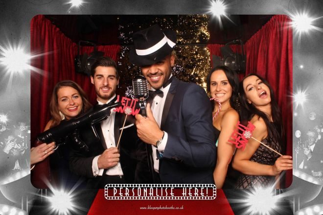 Five Christmas party guests in the paparazzi Red Carpet photo booth