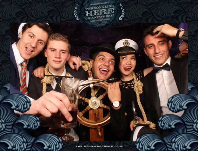 Fun with nautical themed props to compliment the ocean themed photo booth background