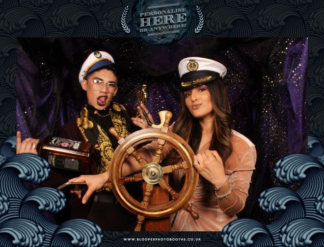Turning the ship wheel inside the Seven Seas themed photo booth