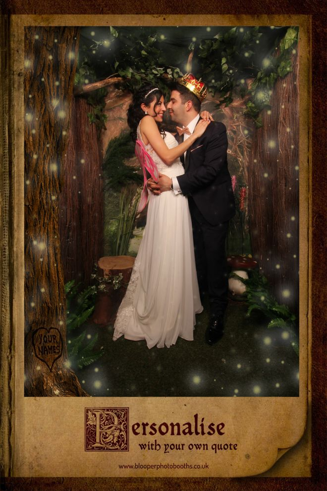 A bride and groom in the Enchanted Forest photo booth with real forest scenery and personalised graphics