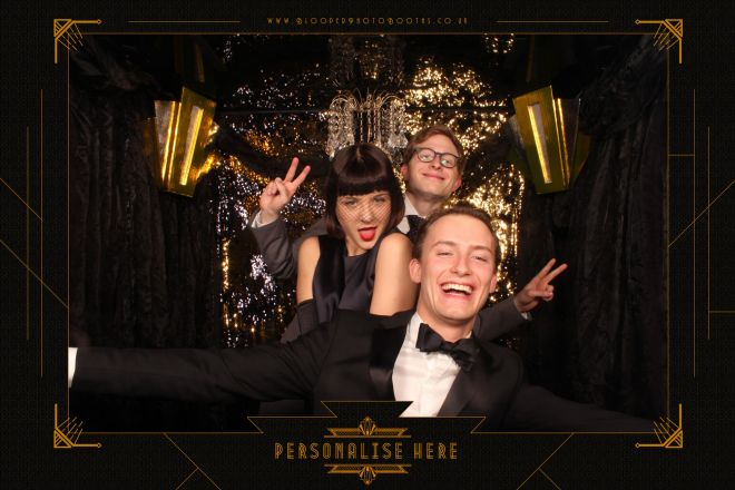 Art deco wall scenery, real chandelier, and glitzy gold curtain in the Great Gatsby photo booth