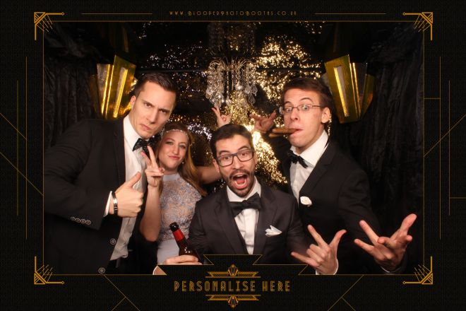 4 guests in the extra large Great Gatsby themed photo booth