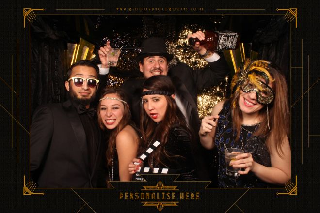 1920s themed props and art deco scenery in the Great Gatsby themed photo booth
