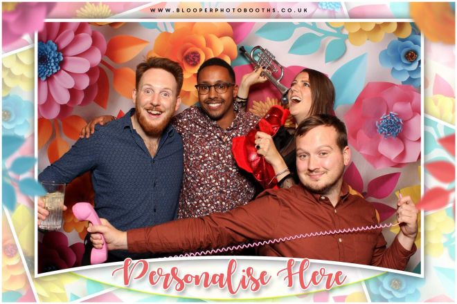 Matching flowery graphics surround the photo booth photo