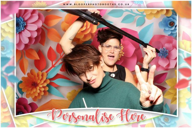 Guests acting cool in front of the 3d flower photo booth backdrop