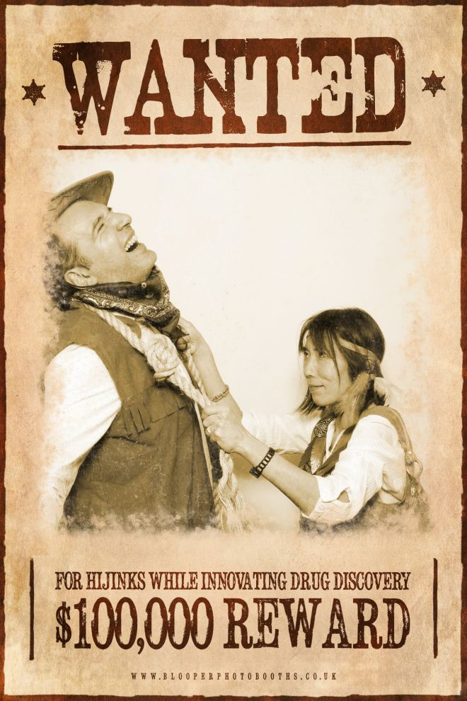Wild west guests in the western themed 'Wanted' poster using the plain white photo booth backdrop and digital filters to age the photo