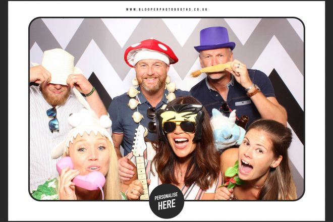 Lots of colourful props pop against the cool and modern black and white photo booth backdrop