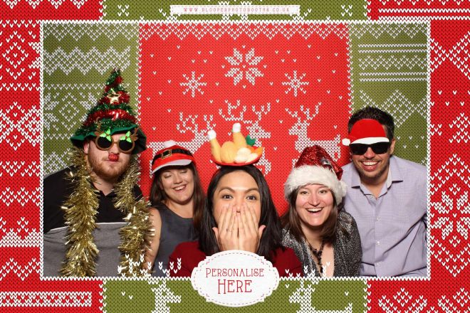 5 Christmas party guests in the Christmas jumper themed photo booth