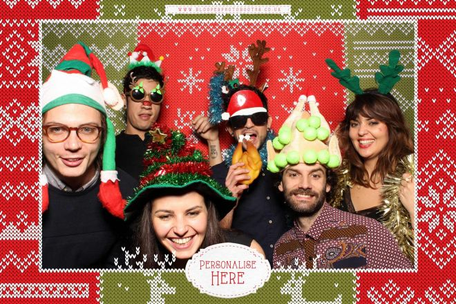 Christmas party photo booth with a knitted Christmas jumper backdrop and theme