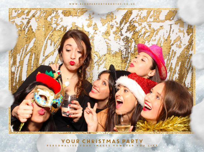 Christmas party guests using the white and gold mermaid sequin backdrop